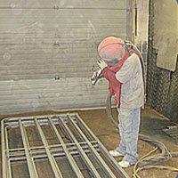 Media Blasting Icon showing a man blasting items